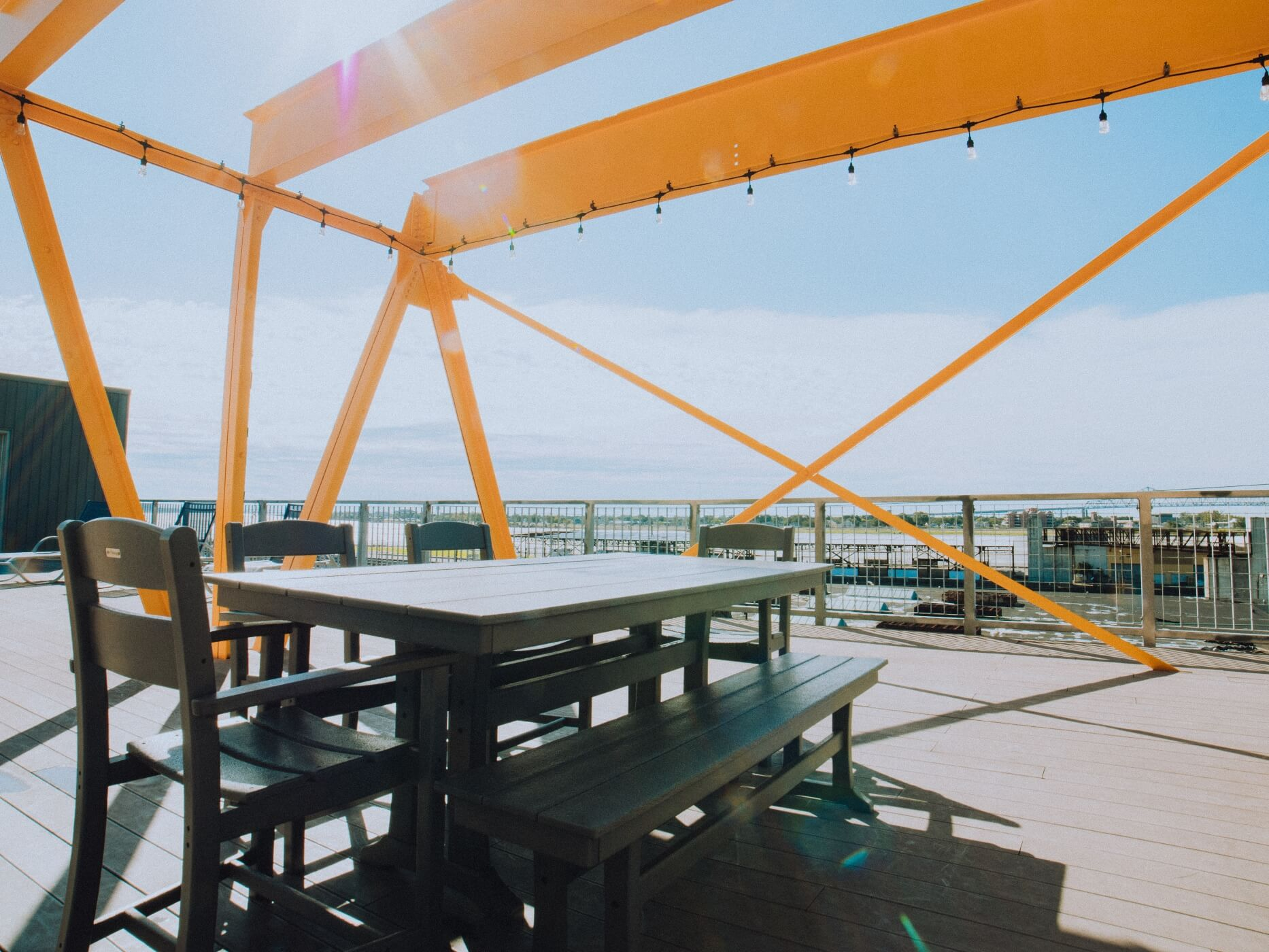 Table and chairs on rooftop deck